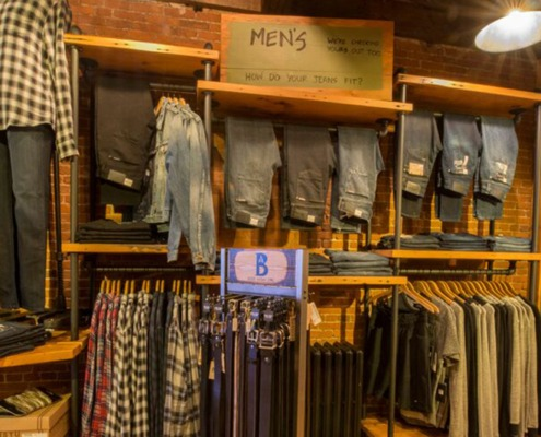 a rack of designer denim in our mens clothes section